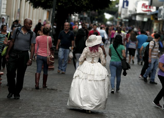 "Adriana Barahona, known as "" Madame Barocle,"" wearing clothing of the Victorian era, walks along a central  avenue in San Jose, Costa Rica June 4, 2015. Barahona says she has been passionate about clothing from the era of Britain's Queen Victoria (1837-1901), and has been making and wearing them since the age of 15. REUTERS/Juan Carlos Ulate"