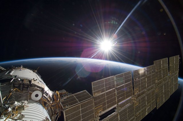 The bright sun greets the International Space Station in this November 22, 2009 scene from the Russian section of the orbital outpost, photographed by one of the STS-129 crew members. (Photo by NASA)