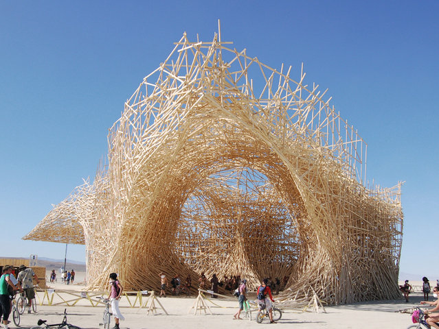 Uchronia at Burning Man, Nevada, USA, by Arne Quinze. Call it a pop-up city: each summer Black Rock City is built in the Nevada desert for the week-long Burning Man festival before disappearing for another year. This installation by the Belgian artist Arne Quinze was built at the 2006 event from 100 miles of wooden beams. When the festival was over it was, appropriately, set alight. (Photo by Jason Strauss/The Guardian)