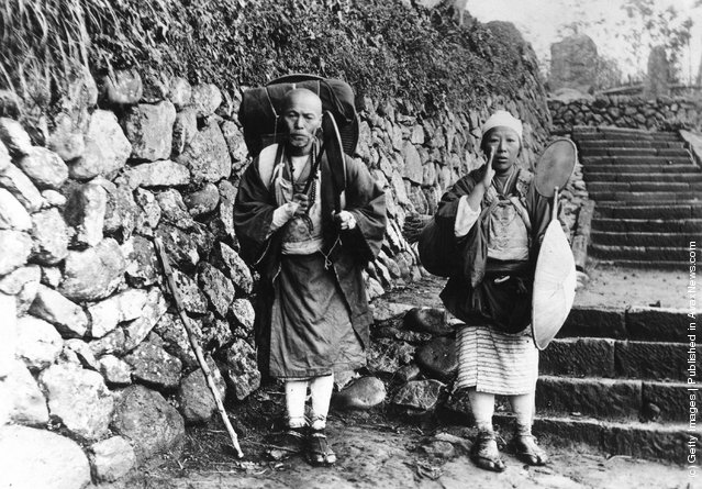 1925: Husband and Wife pilgrims praying on their way to a Temple of Nichiren Sect in Minobu, Japan