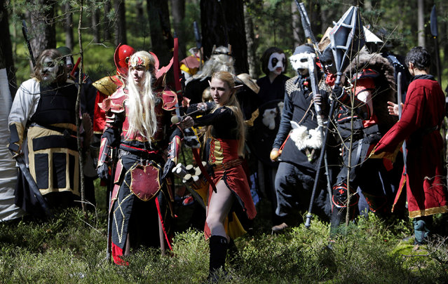 """People dressed as characters from the computer game """"World of Warcraft"""" fight during a battle near the village of Sosnova, Czech Republic, April 30, 2016. (Photo by David W. Cerny/Reuters)"""