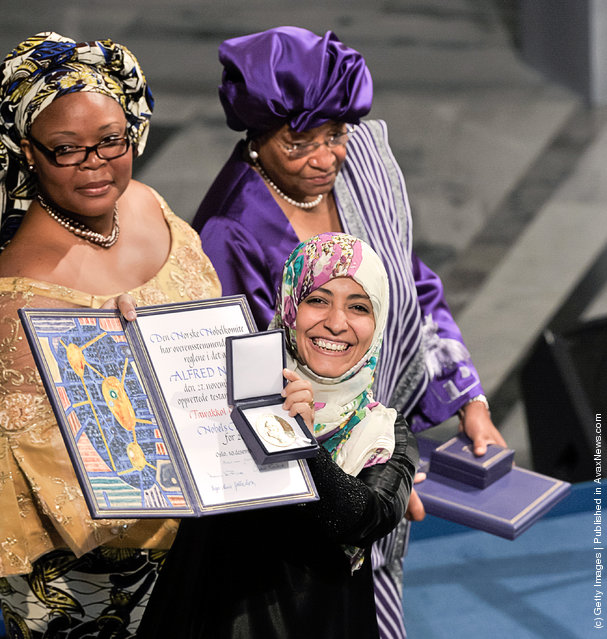 (L-R) Leymah Gbowee of Liberia, Ellen Johnson Sirleaf President of Liberia and Tawakkol Karman of Yemeni, joint winners of the Nobel Peace Prize, pose during the Nobel Peace Prize Award ceremony at Oslo City Hall