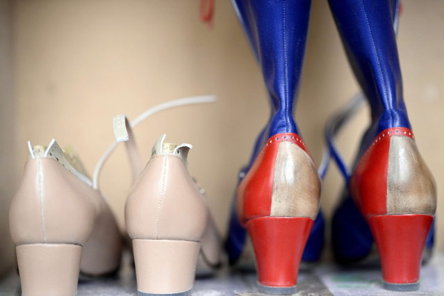 """This picture taken on April 22, 2014 in Paris, shows shoes made by the """"Maison Clairvoy"""". Since 1945, the """"Maison Clairvoy"""" is specialised in the creation of luxury shoes and started in 1960 a collaboration with the famous Moulin Rouge to create boots and shoes for French Cancan dancers. (Photo by Franck Fife/AFP Photo)"""