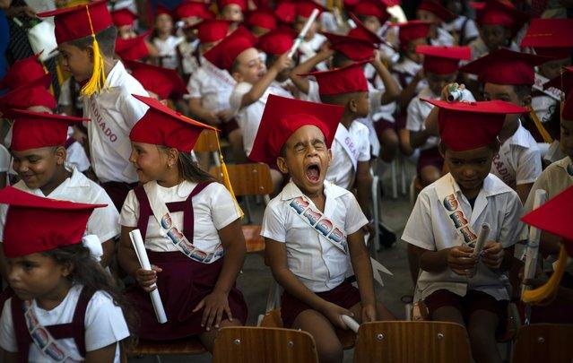 A child yawns during his kindergarten graduation ceremony in Havana, Cuba, Friday, June 21, 2019. (Photo by Ramon Espinosa/AP Photo)