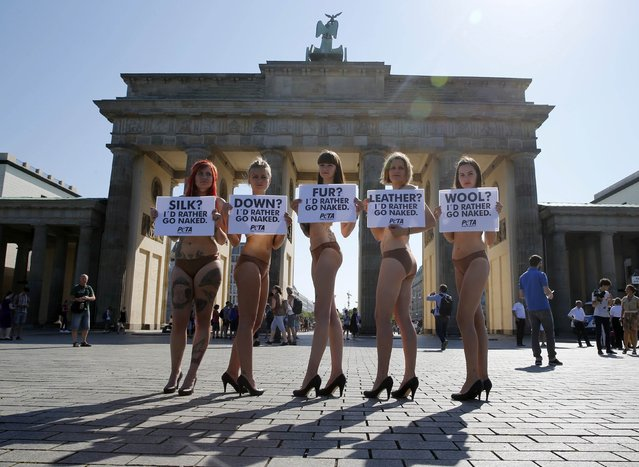 PETA (People for the Ethical Treatment of Animals) activists protest in front of Brandenburg Gate prior to the opening of Berlin Fashion Week Spring/Summer 2016, in Berlin, Germany July 7, 2015. (Photo by Fabrizio Bensch/Reuters)