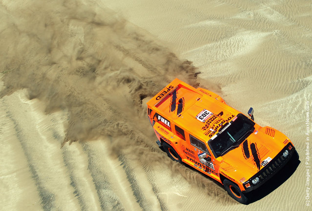 Robbie Gordon of the USA drives his Hummer through the sand dunes on stage one of the 2012 Dakar Rally