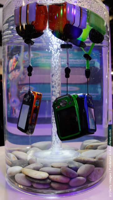 Fujifilm FinePix digital cameras are displayed in water to demonstrate that they are waterproof (up to to 32.8 feet) at the 2012 International Consumer Electronics Show