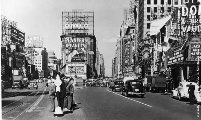 A view of Times Square at the intersection of Broadway and 7th Avenue, New York City, New York, 1937