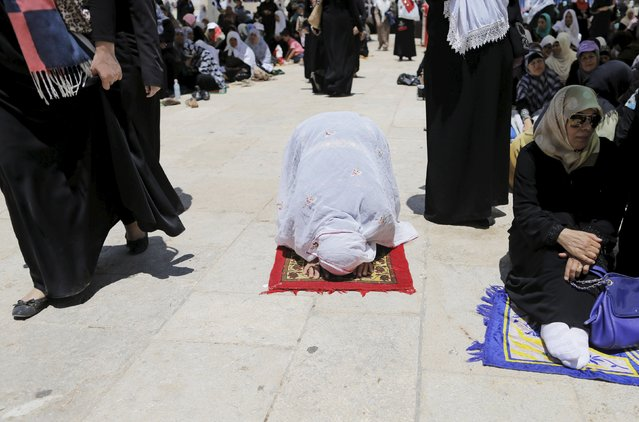 A Palestinian woman prays on the fourth Friday of the holy month of Ramadan at the compound known to Muslims as the Noble Sanctuary and to Jews as Temple Mount, in Jerusalem's Old City July 10, 2015. (Photo by Ammar Awad/Reuters)