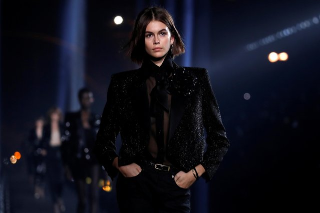 Kaia Gerber presents a creation by designer Anthony Vaccarello as part of his Spring/Summer 2020 women's ready-to-wear collection show for fashion house Saint Laurent during Paris Fashion Week in Paris, France, September 24, 2019. (Photo by Gonzalo Fuentes/Reuters)