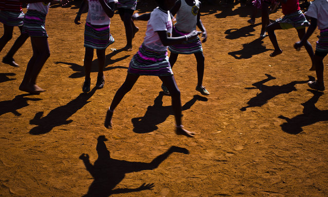 Children perform cultural dances at an election rally of incumbent President Jacob Zuma's African National Congress (ANC), in the mining town of Bekkersdal, Gauteng province, South Africa Saturday, May 3, 2014. (Photo by Ben Curtis/AP Photo)