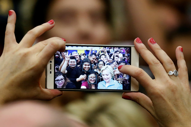 U.S. Democratic presidential candidate Hillary Clinton takes a selfie with supporters after speaking at the University of California Riverside in Riverside, California, U.S. May 24, 2016. (Photo by Lucy Nicholson/Reuters)