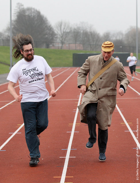Former 'Monty Python' actor Michael Palin (C) attends a 'Hopathon' world record attempt on Hampstead Heath athletics track on March 3, 2012 in London