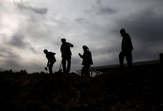 Workers break rocks at the Jabal Saraj cement factory in Jabal Saraj, north of Kabul, Afghanistan April 19, 2016. (Photo by Ahmad Masood/Reuters)