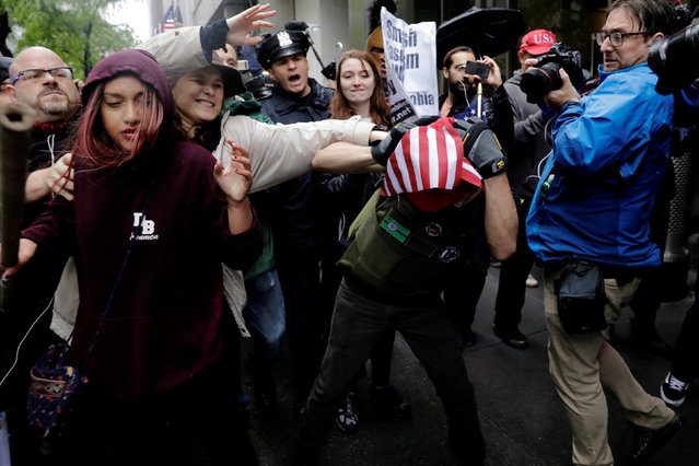 Anti-Trump demonstrators (L) grapple over a U.S. flag with demonstrators protesting against CUNY's decision to allow Linda Sarsour, a liberal, Palestinian-American political activist, to speak at this year's commencement in New York, U.S., May 25, 2017. (Photo by Lucas Jackson/Reuters)