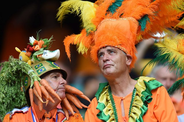Fans of the Netherlands look on before a Group B football match between Spain and the Netherlands at the Fonte Nova Arena in Salvador during the 2014 FIFA World Cup on June 13, 2014. (Photo by Javier Soriano/AFP Photo)