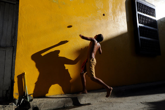 """The Flying Ball"". Children of the streets. Photo location: Barakoa, Cuba. (Photo and caption by Dana Caspi/National Geographic Photo Contest)"