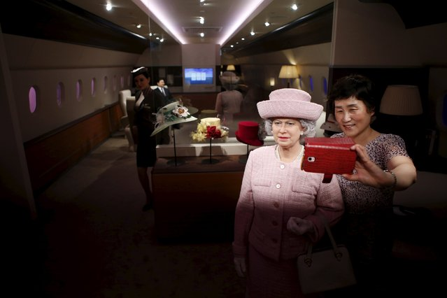A woman takes a selfie with the wax figure of Britain's Queen Elizabeth II at Grevin Wax Museum in central Seoul, South Korea, July 30, 2015. (Photo by Kim Hong-Ji/Reuters)