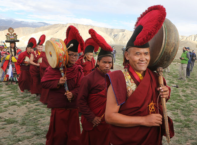 Monks return to the city after performing ceremonies in a nearby field during the Tenchi Festival on May 27, 2014 in Lo Manthang, Nepal. The Tenchi Festival takes place annually in Lo Manthang, the capital of Upper Mustang and the former Tibetan Kingdom of Lo. Each spring, monks perform ceremonies, rites, and dances during the Tenchi Festival to dispel evils and demons from the former kingdom. (Photo by Taylor Weidman/Getty Images)