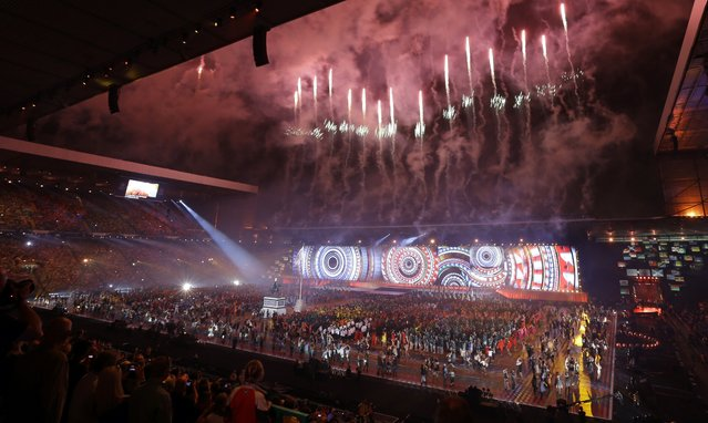 Fireworks explode overhead during the opening ceremony for the Commonwealth Games 2014 in Glasgow, Scotland, Wednesday July 23, 2014. (Photo by Kirsty Wigglesworth/AP Photo)