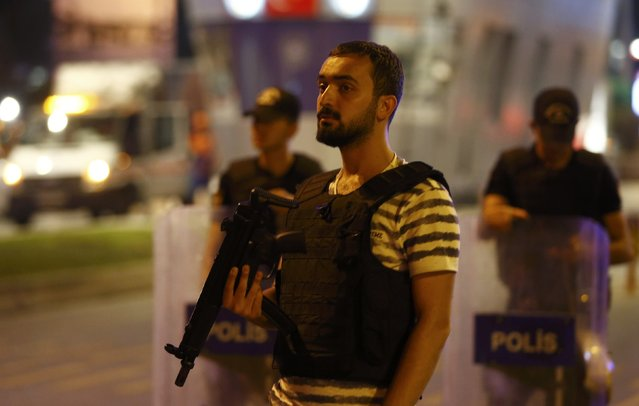 Police guard the entrance to Turkey's largest airport, Istanbul Ataturk, Turkey, following a blast June 28, 2016. (Photo by Osman Orsal/Reuters)