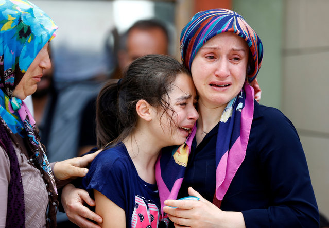 Relatives of one of the victims of yesterday's blast at Istanbul Ataturk Airport mourn in front of a morgue in Istanbul, Turkey, June 29, 2016. (Photo by Osman Orsal/Reuters)