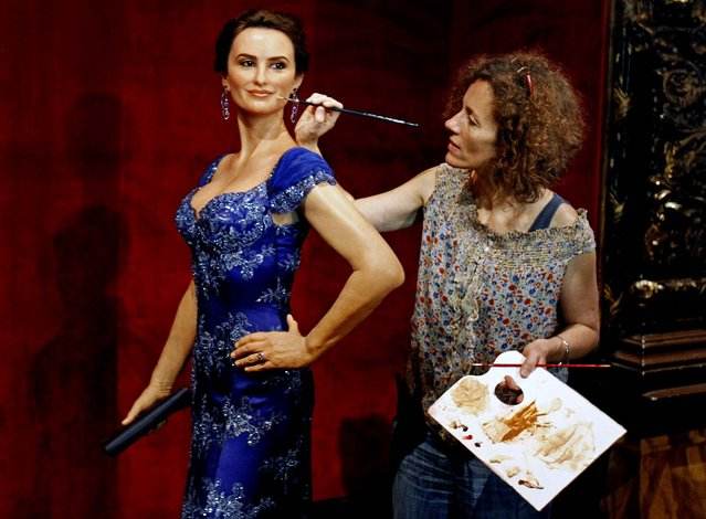 Make-up artist Valerie Merceron gives the final touch to the wax figure of Spanish actress Penelope Cruz which was unveiled at the Grevin Wax Museum in Paris on July 26, 2012. (Photo by Remy de la Mauviniere/Associated Press)