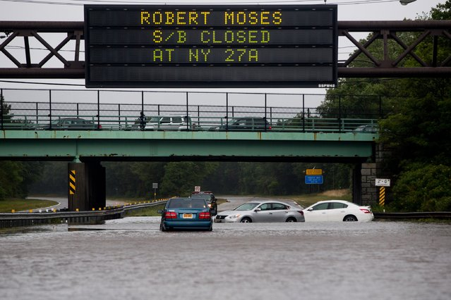 Cars are abandoned on the Southern State Parkway following heavy rains and flash flooding August 13, 2014 in Islip, New York. The south shore of Long Island along with the tri-state region saw record setting rain that caused roads to flood entrapping some motorists. (Photo by Andrew Theodorakis/Getty Images)