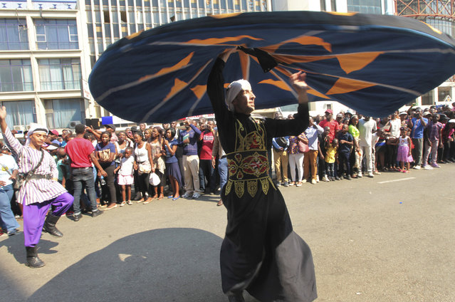 In this picture taken Saturday, September 9, 2017, a dancer from Egypt performs on the streets of Harare during the International Carnival in the capital. (Photo by Tsvangirayi Mukwazhi/AP Photo)