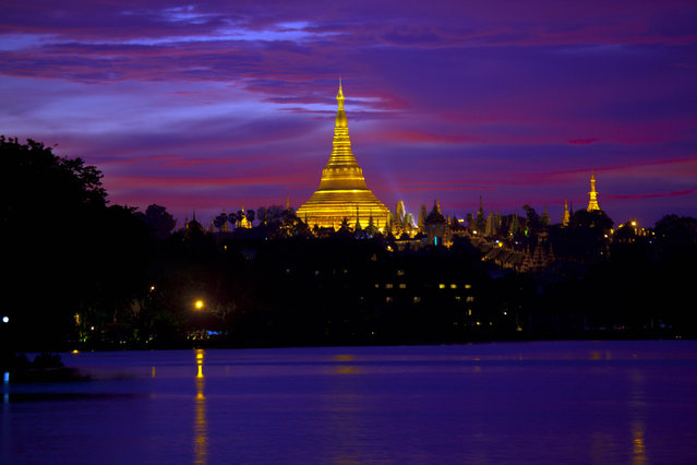 Myanmar Landmark Shwedagon is seen from National Kandawgyi park while its illuminated on Thursday, May 29, 2014, in Yangon, Myanmar. (Photo by Khin Maung Win/AP Photo)