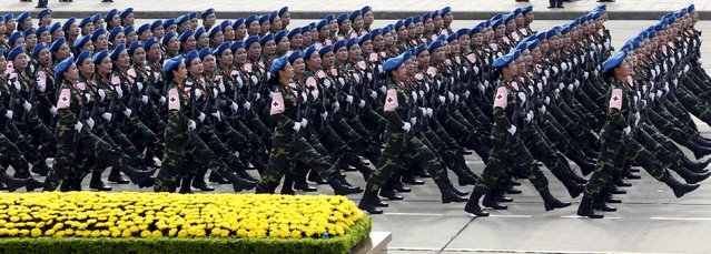Vietnamese female military doctors march during a parade marking Vietnam's 70th National Day at Ba Dinh square in Hanoi, Vietnam September 2, 2015. (Photo by Reuters/Kham)