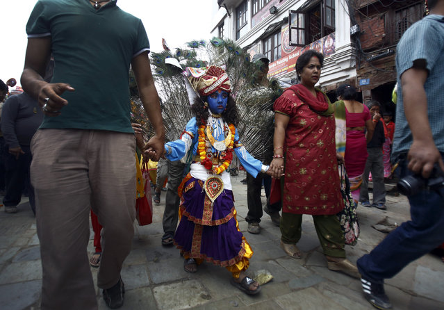 A boy dressed as Lord Krishna participates in a parade to mark the Gaijatra Festival in Kathmandu August 22, 2013. (Photo by Navesh Chitrakar/Reuters)