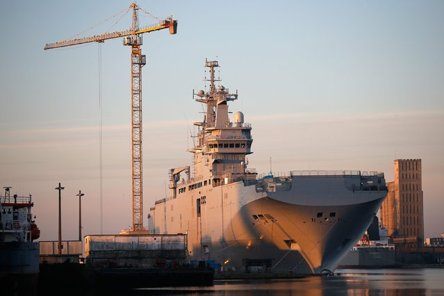 The Mistral-class helicopter carrier Vladivostok is seen at the STX Les Chantiers de l'Atlantique shipyard site in Saint-Nazaire, September 4, 2014. France will not deliver the first of two helicopter carriers to Russia for now because of Moscow's actions in eastern Ukraine, the French president's office said on Wednesday. (Photo by Stephane Mahe/Reuters)