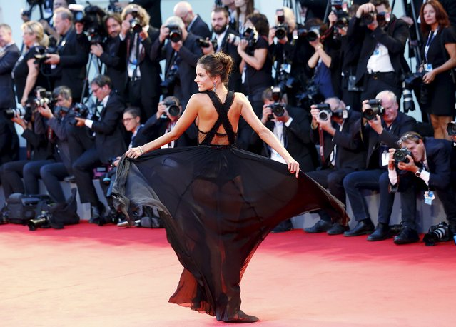 "Model Alessandra Ambrosio poses for photographers during the red carpet for the movie ""Spotlight"" at the 72nd Venice Film Festival in northern Italy, September 3, 2015. (Photo by Stefano Rellandini/Reuters)"