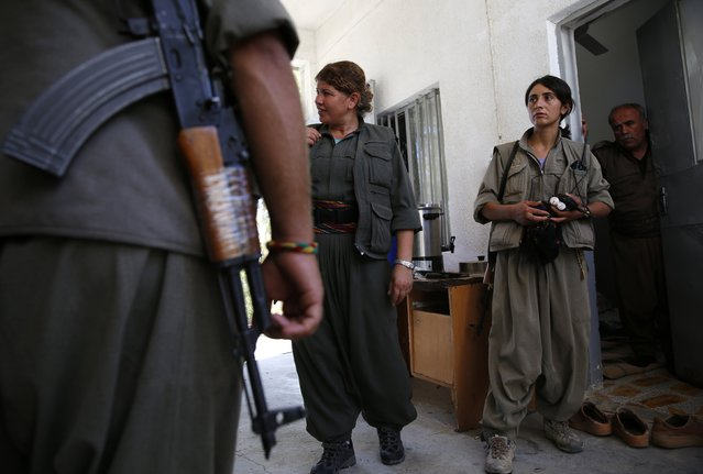Female members of the Kurdistan Workers' Party (PKK) walk at their camp, near the frontline of the fight against Islamic State militants, in Makhmur, south of Erbil, September 13, 2014. (Photo by Ahmed Jadallah/Reuters)