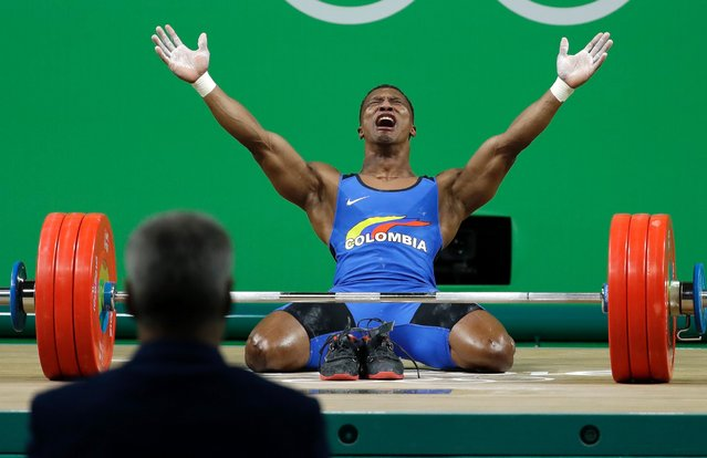 Oscar Albeiro Figueroa Mosquera, of Colombia, celebrates after winning the gold medal in the men's 62kg weightlifting competition at the 2016 Summer Olympics in Rio de Janeiro, Brazil, Monday, August 8, 2016. Mosquera retired after his last lift. (Photo by Mike Groll/AP Photo)