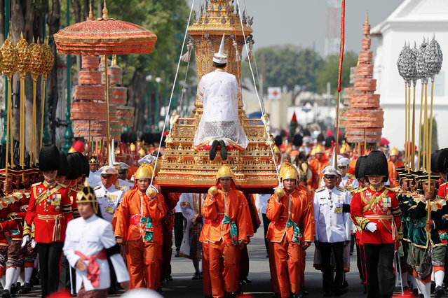 The Royal Urn of Thailand's late King Bhumibol Adulyadej is carried during the Royal Cremation ceremony at the Grand Palace in Bangkok, Thailand, October 26, 2017. (Photo by Damir Sagolj/Reuters)