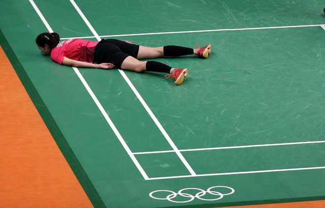 Thailand's Puttita Supajirakul is down on the court after a point during a women's doubles badminton match against the Netherlands at the 2016 Summer Olympics in Rio de Janeiro, Brazil, August 11, 2016. (Photo by Kin Cheung/AP Photo)