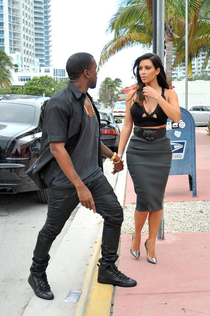 Kim Kardashian looks to have left her underwear at home as she heads out for an early dinner with boyfriend Kanye West in Miami. As Kim checked out her outfit in the reflection of her car, it became apparent that the reality star was not wearing any underwear as she showed off her see-through grey skirt. (Photo by Brett Kaffee/Thibault Monnier/PacificCoastNews.com)