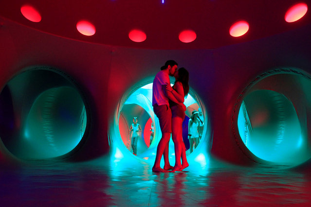 Revellers relax inside a 3-D Luminarium inflatable installation by British designer Alan Parkinson during Sziget music festival on an island in the Danube River in Budapest, Hungary August14, 2016. (Photo by Bernadett Szabo/Reuters)