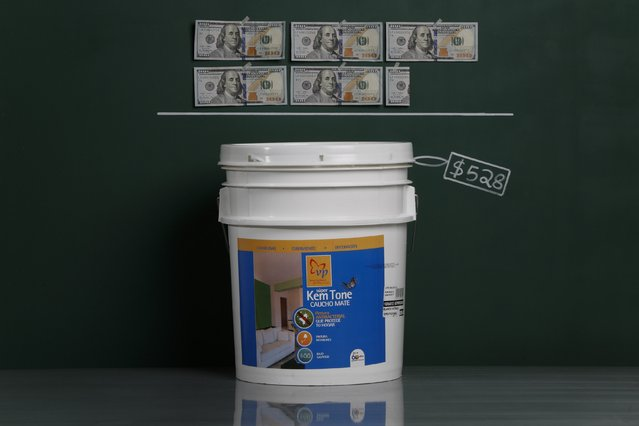 A five-gallon bucket of house paint as photographed in a studio with an illustrative price tag of $528 (US dollars), equivalent to the Bs. 3,329 (bolivars) that it costs on average to purchase in Caracas at the official exchange rate of 6.3 bolivars per dollar, in Caracas September 29, 2014. (Photo by Carlos Garcia Rawlins/Reuters)