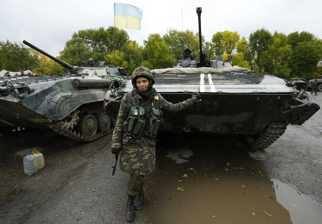 Ukrainian servicewoman Nadie, 36, poses at the military camp in the village of Luhanske, eastern Ukraine September 24, 2014. (Photo by David Mdzinarishvili/Reuters)