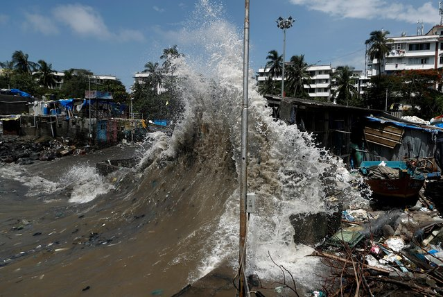 A wave breaks along a seafront during high tide in Mumbai, India on July 24, 2020. (Photo by Francis Mascarenhas/Reuters)