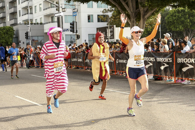 General view of runners preparing to cross the finish line at the Rock 'n' Roll Los Angeles Halloween Half-Marathon and 5K benefitting the ASPCA on October 26, 2014 in Los Angeles, California. (Photo by Rich Polk/Getty Images for CGI)