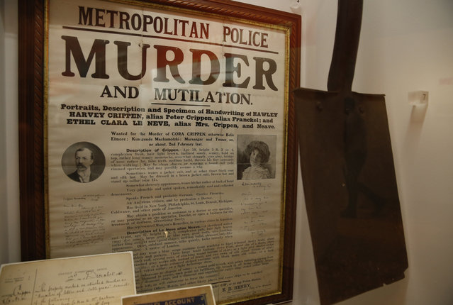 A Metropolitan Police wanted poster for Harvey Crippen and his accomplice Ethel Neve, along with a spade said to have been used in the murder of Crippens wife Cora in 1910,  form part of the Crime Museum Uncovered exhibition at the Museum of London in the City of London, Wednesday, October 7, 2015. Crippen is infamous for being the first criminal to be captured with the aid of wireless telegraphy. (Photo by Alastair Grant/AP Photo)