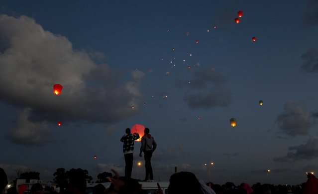 People release lanterns into the air, at Nasr Square in Benghazi, on February 17, 2013, during the second anniversary of the uprising that toppled Libya's longtime dictator Moammar Gadhafi. (Photo by Mohammad Hannon/Associated Press)