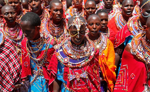 Maasai women sing for their men of Matapato clan before attending the Olng'esherr (meat-eating) passage ceremony to unite two age-sets; the older Ilpaamu and the younger Ilaitete into senior elder-hood as the final rite of passage,o after the event was initially postponed due to the coronavirus disease (COVID-19) outbreak in Maparasha hills of Kajiado, Kenya on  September 23, 2020. During the ceremony, the men were accompanied by their wives, who also wore colorful shawls and beads around their necks and sang songs praising and encouraging the incoming group of elders. (Photo by Thomas Mukoya/Reuters)