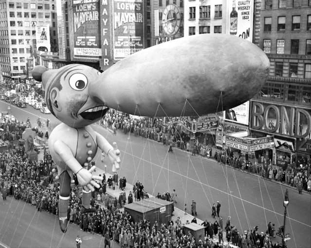 Balloons float down Broadway in thirteenth annual Macy's Thanksgiving Day parade, 1937. Seven musical organizations, twenty-one floats and balloon units and 400 costumed marchers participated in this year's merry cavalcade. All doubt as the existence of Santa Claus was dispelled. He Was There! (Photo by Walter Kelleher/NY Daily News Archive via Getty Images)