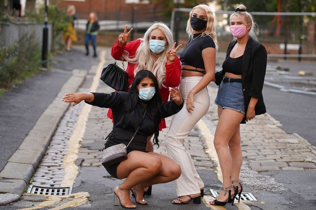 Masked up revellers hit the town in Sheffield, United Kingdom on October 10, 2020 before the Prime Minister introduces a three-tier lockdown system that will see hospitality venues shut in virus hotspots. (Photo by London News Pictures/The Sun)