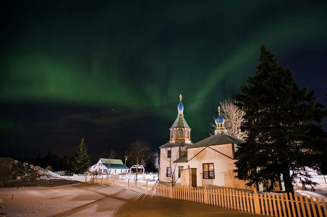 The aurora borealis, or northern lights, fill the sky above the Holy Assumption of the Virgin Mary Russian Orthodox church in Kenai, Alaska, on March 17, 2013. (Photo by M. Scott Moon/Associated Press)